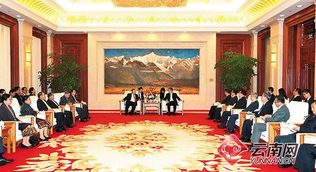 陈豪会见老挝人民革命党中央总书记、国家主席本扬